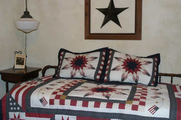 Second bedroom has 2 twin beds covered with handcrafted quilts